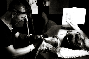 On an off day, Brad finishes a tattoo he had been putting off for his wife, Lucy. She reads.