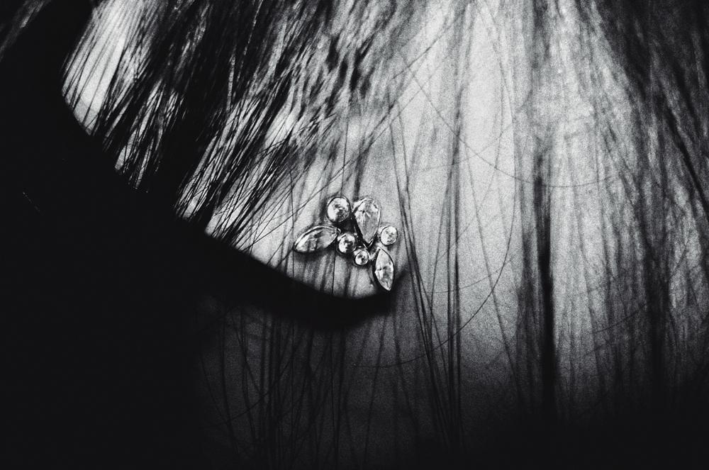 A portrait of an earring, in Seoul, South Korea. Sony DSC-W100.